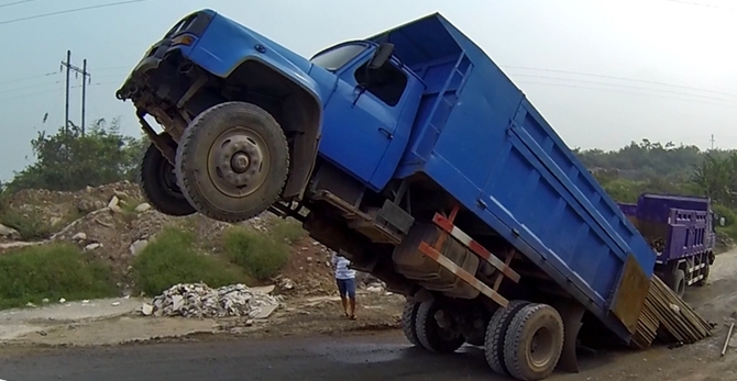 I took this while out motorbiking a few weeks ago.  The weight of fatigue sometimes causes me to tip over like this truck (yes, I am proud of my creativity here!). . .