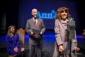 "Anna playing ""Annie"" last week. . . complete with red , curly wig!"