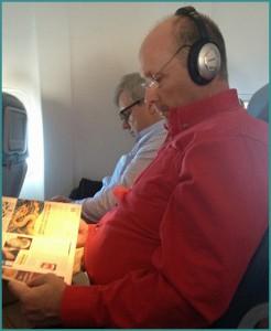 Guy wearing headphones on my flight