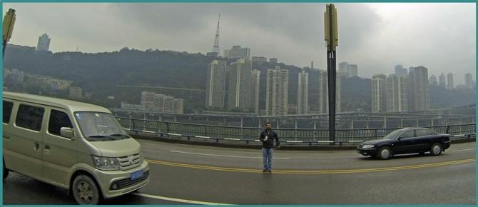 """John Gunter and """"Flat Stanley"""" crossing an Asian street."""